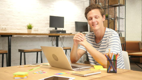 Smiling Creative Man at Work in Loft Office, Satisfied with work done Footage
