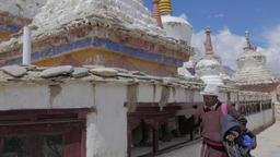 Man spins prayer wheel around gompa,Lamayuru,Ladakh,India Footage
