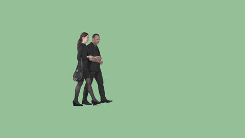 Male in black and tall beautiful girl are walking holding hands and talking Footage