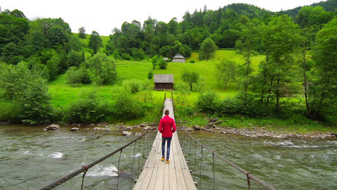 Man Walk Across a Suspension Bridge Footage