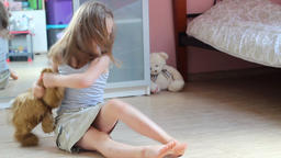 Young girl and brown teddy bear. Domestic violence. Social problems Footage