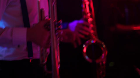Man playing the trumpet during a performance light from the colored spotlights 1 Footage