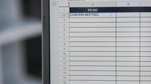 Person marking task CONFIRM MEETINGS WITH CLIENTS in online plan, to-do list Live Action