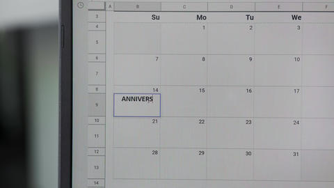 Writing ANNIVERSARY on 14th on calendar to remember this date GIF