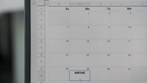 Writing BIRTHDAY on 29th on calendar to remember this date GIF