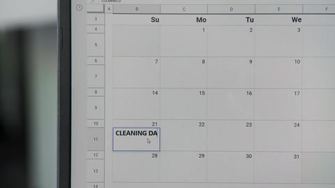 Writing CLEANING DAY on 21th on calendar to remember this date GIF