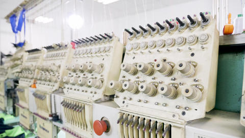Modern sewing machines for cotton in a fabric factory Live Action