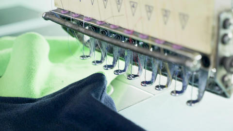 Close up sewing line a modern fabric factory Live Action