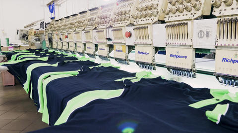 T-shirts on sewing machine in a fabric factory Live Action