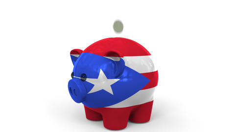 Coins fall into piggy bank painted with flag of Puerto Rico. National banking Live Action
