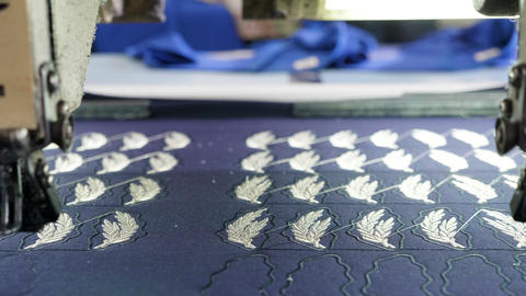 Automatic modern sewing machine embroider a logo on fabric Live Action