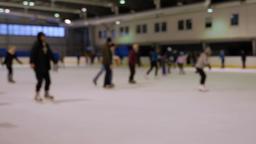 People ice skating. Defocused. Ice skating rink Live Action