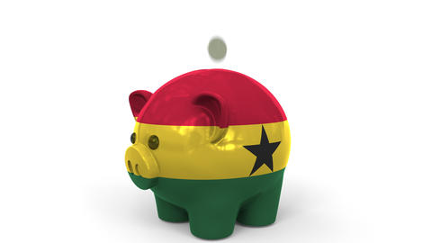 Coins fall into piggy bank painted with flag of Ghana. National banking system Live Action