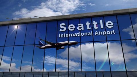 Airplane landing at Seattle Washington mirrored in terminal Live Action