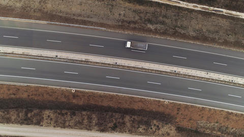 Road top down drone shot aerial truck passing フォト