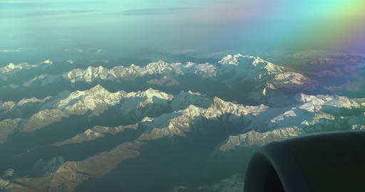 Aerial views in mountain. View from the plane window. Top view Footage