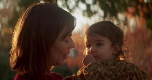 Mother and baby daughter exploring the outdoors during the fall Footage