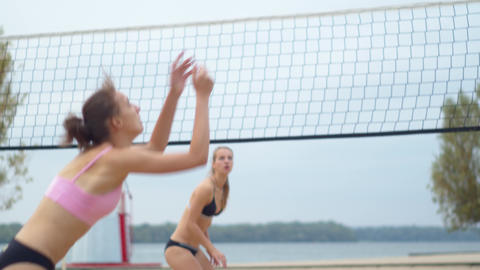 Four women on the beach are playing volleyball, wonder women, 4k Live Action