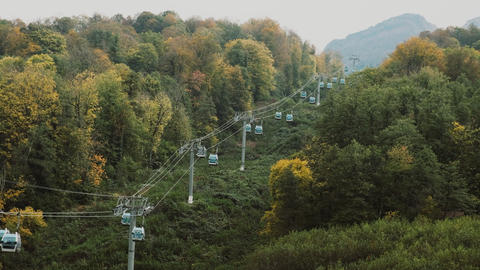Mountain top ski lift station in autumn. Cable car lifts people to the top of Live Action