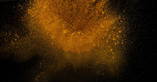 Turmeric, curcuma longa, Powder Exploding against Black Background, Indian Spice, Slow Motion 4K Footage
