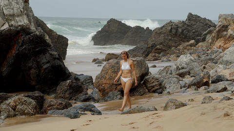 A relaxing day on a sandy beach at the ocean Footage