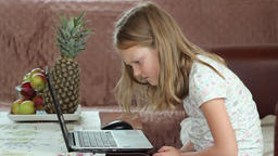 The girl does not know how to use laptop computer Footage