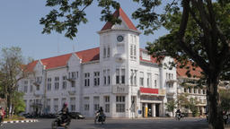 Colonial building and busy traffic in old city,Surabaya,Java,Indonesia Footage
