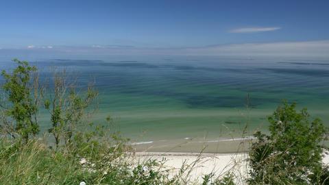 Beach view from cliff. Blue sky. Rügen - Baltic Sea Footage