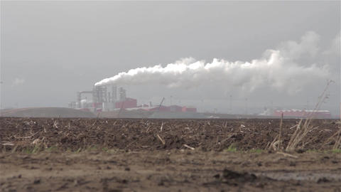 Column of steam rising from chimneys of a factory that sees the end of a fallow Footage