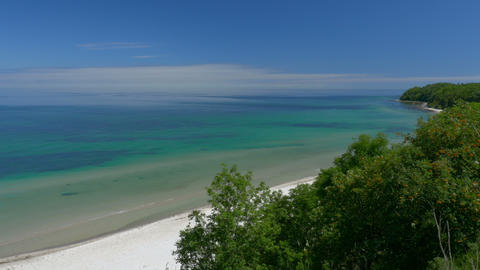 Beach view from cliff. Bay with blue sky. Rügen - Baltic Sea Footage