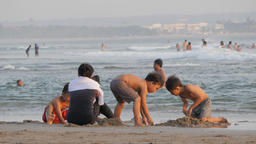 Boys making sand castle on the beach,Kuta,Bali,Indonesia Footage