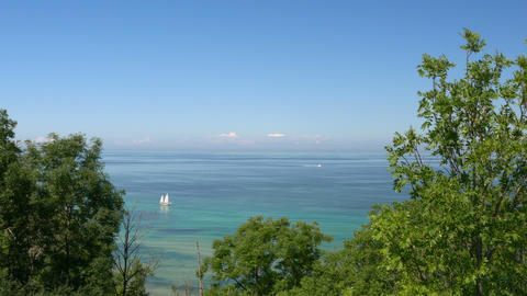Beach view from cliff. Bay with boats and blue sky. Rügen - Baltic Sea Footage