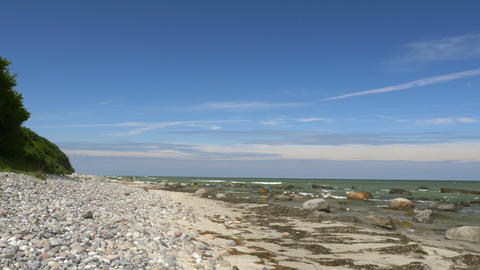 Beach scene with stones and rocks - blue sky. Rügen - Baltic Sea Footage