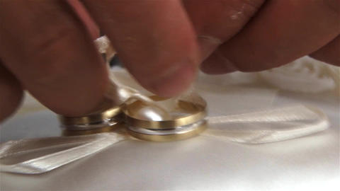 Man comes with a lanyard two rings that will lead them to church religious weddi Footage