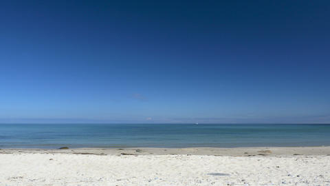 Beach scene without people. Peaceful and relaxing. White sand and blue sky Footage