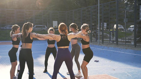 Attractive picture of beautiful sporty slim women which making circle with hands Live Action