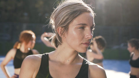 Pretty tired sporty female fitness instructor posing on camera after sport Footage