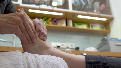 Pedicure and foot massage in beauty salon for women and men Footage