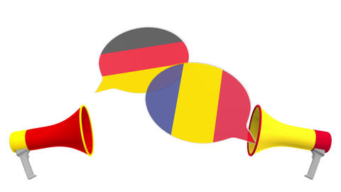 Flags of Romania and Germany on speech balloons from megaphones. Intercultural Live Action