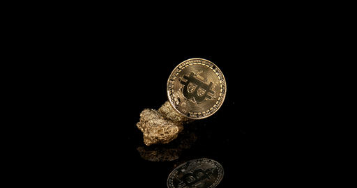 Gold Nugget and Bitcoins on Black Background, slow motion 4K Footage