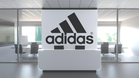 Logo of ADIDAS on a wall in the modern office, editorial conceptual 3D animation Live Action