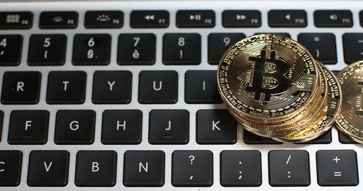 Bitcoins on Computer Keyboard Background, Slow Motion 4K Footage