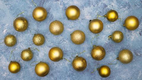 Gold balls on blue background make beautiful Christmas frame - Stop motion animation Animation