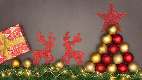 Red Christmas decoration on grey background and Christmas lights blinking - Stop motion animation Animation