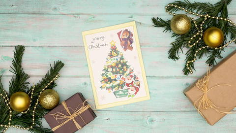 Stop motion animation of Christmas card moving on wooden background CG動画