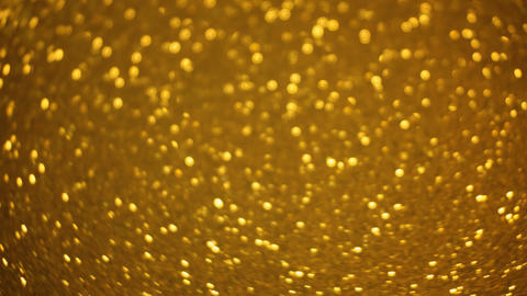 Rotating Sparkling Golden Glitter Bokeh Animation