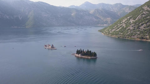 Aerial footage of St. George and monastery on the islands near Perast town in Footage