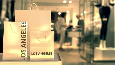 Shopping bags with LOS ANGELES text against blurred… Stock Video Footage