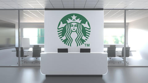 STARBUCKS logo above reception desk in the modern office, editorial conceptual Live Action