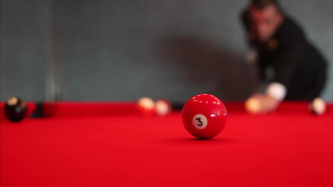 A guy plays billiard / Hit the ball Footage